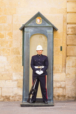 MLT0578AW Malta, South Eastern Region, Valletta. A guard stands outside the Presidential Place in St Georges Square.