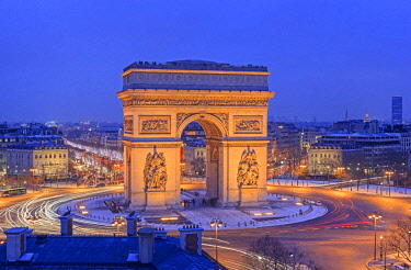 HMS1356882 France, Paris, the Arc de Triomphe and the Charles de Gaulle Place illuminated at night, the Champs Elysees avenue in the background