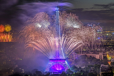 HMS2004159 France, Paris, the Eiffel tower illuminated  and the fireworks of the Bastille Day (French National Day) celebrated on 14 July
