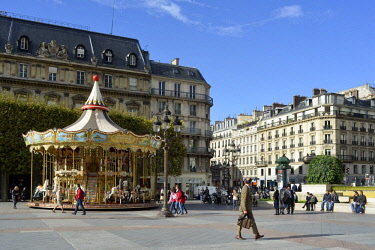 HMS2068683 France, Paris, Esplanade of the City hall, goes and comes from passers by in front of a merry go round