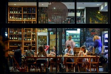 HMS2402804 France, Paris, Quay of Jemmapes, La Vache dans les Vignes restaurant, consumers inside a restaurant