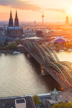 CLKAB60838 Hohenzoller Bridge over River Rhine and Cologne Cathedral at sunset in Cologne city. Cologne city (Koln), North Rhine Westphalia, Germany, Europe.
