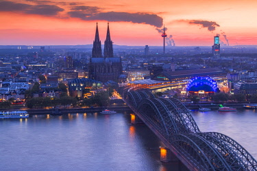 CLKAB60839 Cologne Cathedral and Hohenzoller Bridge over River Rhine in Cologne city at dusk. Cologne city (Koln), North Rhine Westphalia, Germany, Europe.