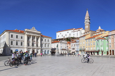 CLKMG57517 Europe, Slovenia, Istria, Piran. Tourists and bikers in Tartini square