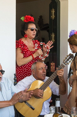 SPA7273AW Singing flamenco in one of the Hermandades (Brotherhoods) of the village. El Rocio pilgrimage, Andalusia. Spain