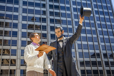 USA12755AW A large version of American realist artist, Seward Johnson's 'Return Visit' sculpture. It is installed in Pioneer Court.  Abraham Lincoln handing a copy of the Gettysburg Address to a modern-day man w...