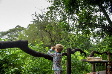 TZ02186 Child looking through binoculars, Lake Manyara, Tanzania