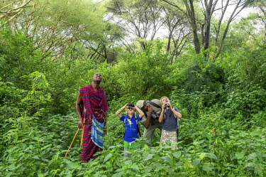 TZ02192 Children looking through binoculars, Lake Manyara, Tanzania