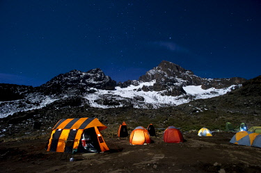 TZ02217 Camping under the full moon, night shot of Mount Kilimanajro with tents.