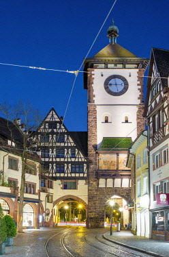 GER9877AW Germany, Baden-Württemberg, Freiburg im Breisgau. Schwabentor (Swabian Gate) at night. Also called Obertor in the Middle Ages, one of two remaining city gates of Freiburg.