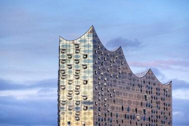 GER9965AW Germany, Hamburg, HafenCity. Elbphilharmonie (Elbe Philharmonic Hall) concert hall at sunset.