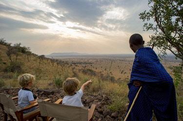 TZ02226 Children with Maasai Warrior, Serengeti, Tanzania