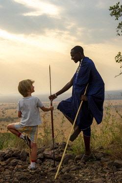 TZ02229 Children with Maasai Warrior, Serengeti, Tanzania