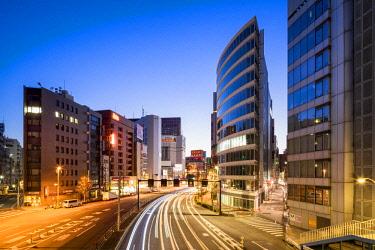 JAP1178AW Modern office buildings along a street in Shinjuku, Tokyo, Japan