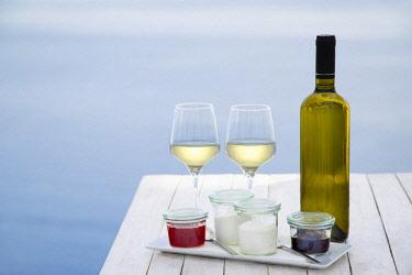 GRE1439AW Local wine with yogurt and jam, Oia, Santorini island, Cyclades, Greece