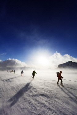 SWI7956 Europe, Switzerland, Valais, Saas-fee, ski tourers in windy conditions