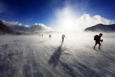 SWI7957 Europe, Switzerland, Valais, Saas-fee, ski tourers in windy conditions