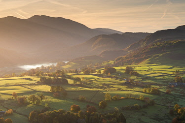 ENG14613AW Sunlit rolling countryside near Keswick, Lake District National Park, Cumbria, England. Autumn (November) 2016.