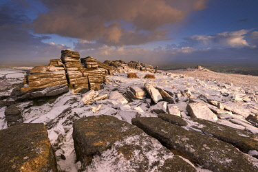 ENG14631AW Snow dusted granite outcrops on Belstone Tor, Dartmoor, Devon, England. Winter (January) 2016.