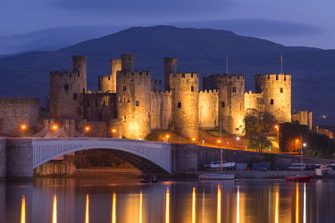 WAL7616AW Conwy Castle illuminated at night, Conwy, Wales. Spring (May) 2017.