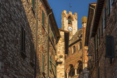 ITA10978AW Italy, Tuscany, Suvereto. Medieval town center with clock tower.