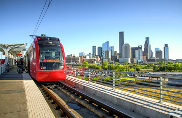 US13250 Texas, Houston, Elevated MetroRail Red Line Station, Near Northside Neighborhood, Skyline