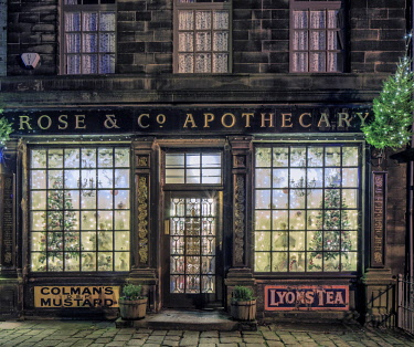 ENG14724AW England, Yorkshire, Haworth. An old fashioned apothecary shop at Christmas time.