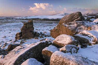 ENG14647AW Snow dusted granite outcrops on Hound Tor, Dartmoor National Park, Devon, England. Winter (January) 2017.