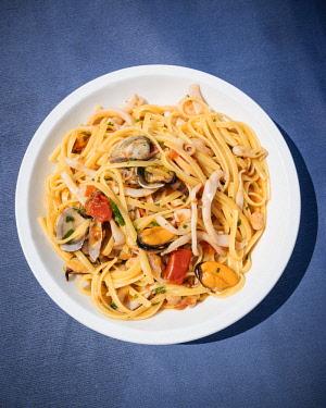 ITA10965AW Traditional dish of seafood linguine at La Rotonda Restaurant, Savelletri, Puglia, Italy, Europe