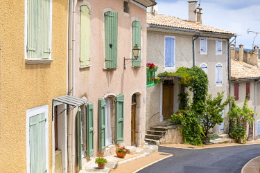 FRA9969AW France, Provence Alps Cote d'Azur, Haute Provence, colourful houses in Banon