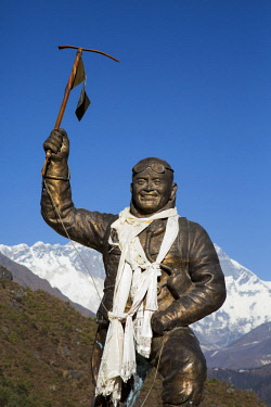 NEP2153 Namche Bazaar, Nepal. A statue of Sherpa Tenzing with the Mount Everest range behind.