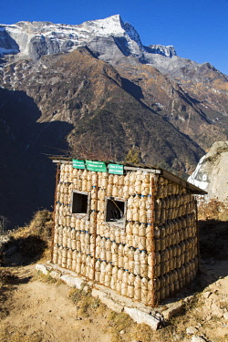 NEP2157 Namche Bazaar, Nepal. A recycling hut, made out of plastic bottles.
