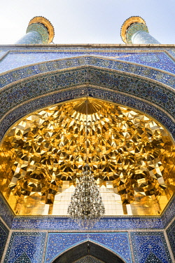 IRA1199 Iran, Qom. The ornate geometric golden domed ceiling of the Hazrat-e Masumeh mosque.  Shi'a Muslims regard Qom as an important Holy City.