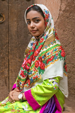 IRA1234 Iran, Abyaneh. An attractive young girl in Abyaneh village. The village is one of the oldest and most traditional in Iran, attracting many tourists.