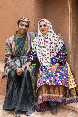 IRA1235 Iran, Abyaneh. A young couple in Abyaneh village. The village is one of the oldest and most traditional in Iran, attracting many tourists.