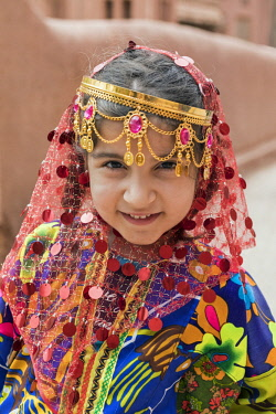 IRA1238 Iran, Abyaneh. A pretty young girl in traditional costume in Abyaneh village. The village is one of the oldest and most historical in Iran, attracting many tourists.