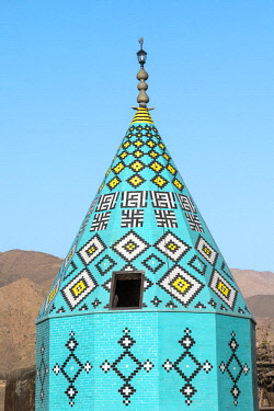 IRA1245 Iran, Abyaneh. The octagonal cone-shaped tiled roof of the 14th century Imamzadeh-ye Yahya shrine in Abyanaeh village. The village is one of the oldest and most traditional in Iran, attracting many to...