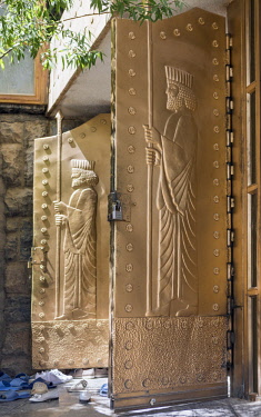 IRA1250 Iran, Chak Chak. The brass doors to the Zoroastrian fire temple of Pir-e Sabz near Chak Chak.  The temple is the most important Zoroastrian pilgrimage site in Iran. The doors depict the likeness of th...