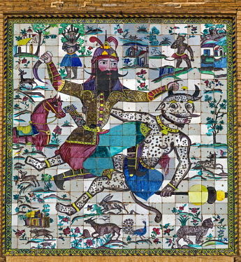 IRA1294 Iran, Shiraz. The coloured tiles over the entrance to the Kharim Khan citadel depict a scene of Rostam killing the white demon. The citadel was built in the late 18th century to become the state capit...