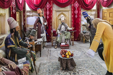 IRA1295 Iran, Shiraz. Life size wax figures in the museum inside Kharim Khan citadel re-inact an audience scene with Karim Khan. The citadel was built in the late 18th century to become the state capital and...