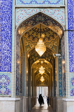IRA1305 Iran, Shiraz. An ornate vaulted passageway leading to the expansive courtyard of the Shah Cheragh shrine in Shiraz. The shrine is the holiest pilgrimage site for Shia Muslims in Shiraz.