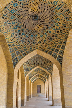 IRA1308 Iran, Shiraz. A passageway of beautifully decorated arches leads to the Nasir al-Mulk Mosque, known as the Pink Mosque due to the predominant colour of its tiles.  The mosque was built between 1876 an...