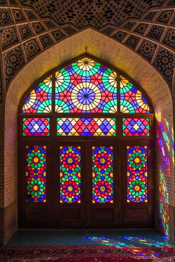 IRA1311 Iran, Shiraz. A stained glass window in the exquisite Nasir al-Mulk Mosque, known as the Pink Mosque due to the predominant colour of its tiles.  The mosque was built between 1876 and 1888.