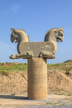 IRA1340 Iran, Persepolis. This double Griffin protome capital is masterpiece of Achaemenid art.  Persepolis was the ceremonial capital of the Achaemenid Empire and dates back to 515 BC.