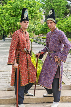 IRA1366 Iran, Shiraz. Two young men in traditional costume in Jahan Nama Garden.