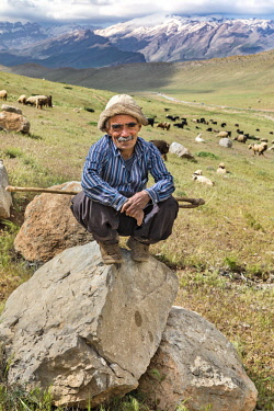IRA1388 Iran, Semiron.  A nomadic shepherd tends his flock of sheep and goats in the foothills of the Zagros Mountains.
