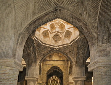IRA1402 Iran, Esfahan.  The outstanding brickwork of the 900 years old Taj al-Molk dome in the Jameh Mosque.