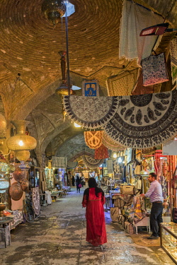 IRA1420 Iran, Esfahan.  Shops line the arched brick passageways of Bazar Bozorg.  This grand bazaar was originally constructed in 11th century but the existing structures date from the Safavid period in the 1...