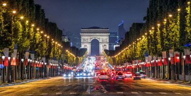 FRA10025AW Champs Elysees & Arc de Triomphe at dusk, Paris, France.