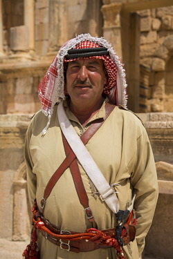 JOR0487 Jerash, Jordan. A retired soldier on duty in the South Theatre.